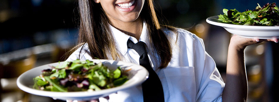 Photo of waitress carrying salads. (c) Can Stock Photo