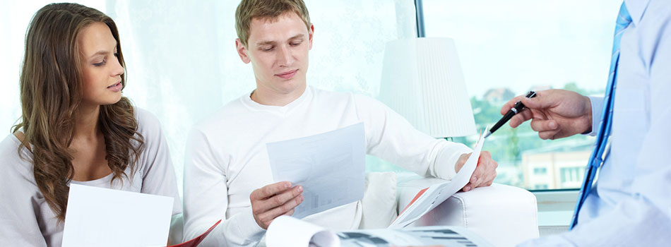 Young people looking through documents to find the best insurance program. (c) Can Stock Photo