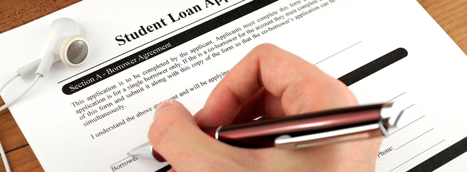 person filling out student loan application. (c) Can Stock Photo