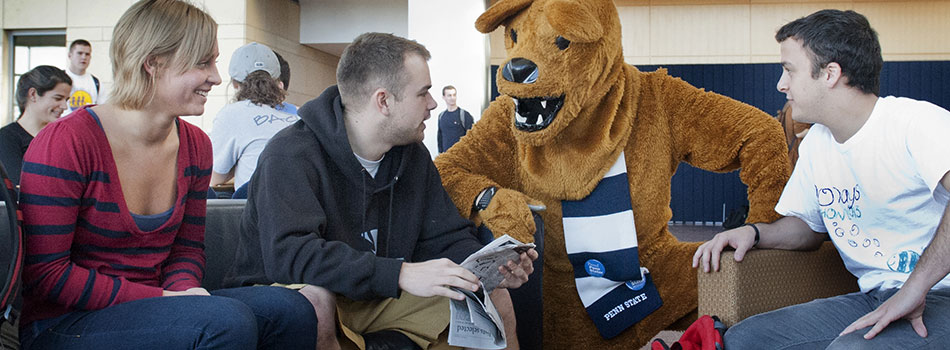 Nittany Lion mascot talking with students. (c) Penn State University